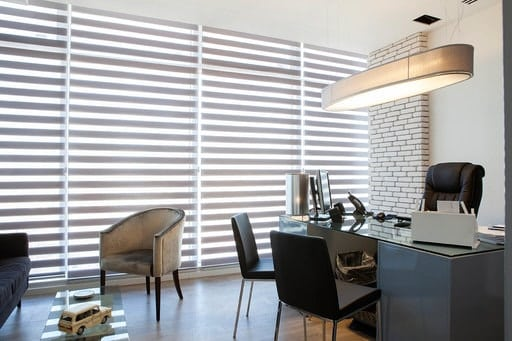 Zebra shades with an innovative look, provide multiple shading options in an office area